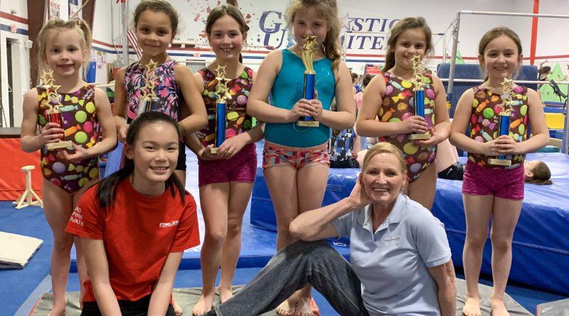 gymnastics unlimited coach chris rising stars trophies