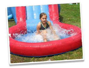 Girl on inflatable pool slide